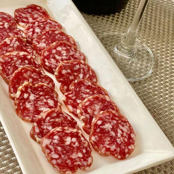 Salamini Italiani alla Cacciatore DOP with a glass of Foss Marai extra dry