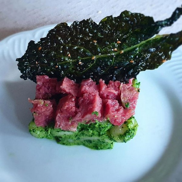 Cotechino Modena IGP with black cabbage pesto and black cabbage chips with sesame